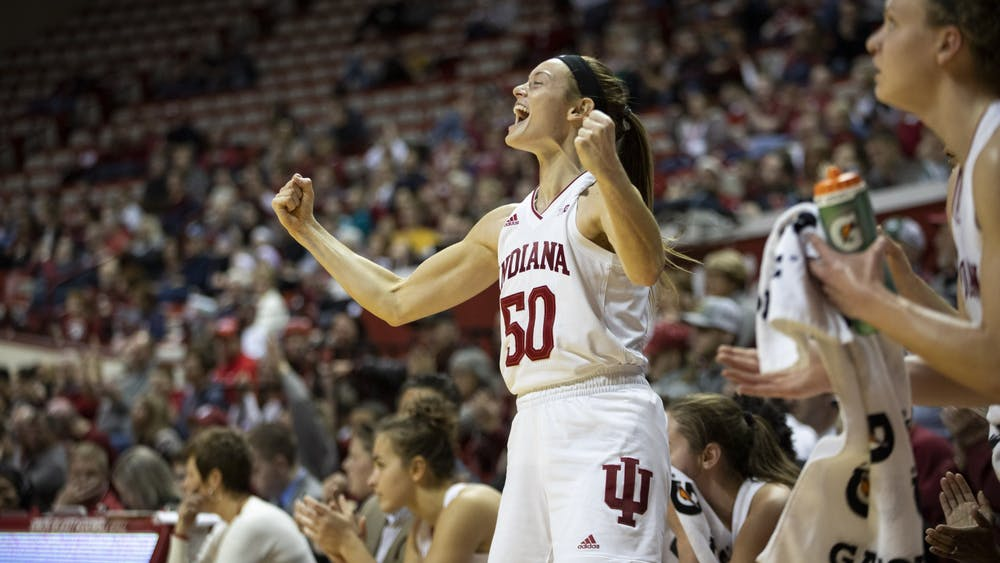 Then-senior Brenna Wise celebrates on the sideline Dec. 15, 2019, in Simon Skjodt Assembly Hall. Wise recorded 1,421 points and 849 rebounds over the course of her career at IU.