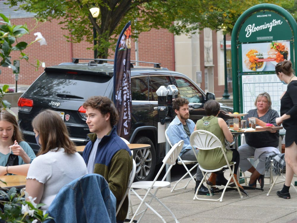 Diners eat outside a restaurant Sept. 24 on Kirkwood Avenue. The inaugural Bloomington Restaurant Week will feature special discounted lunch, dinner and carryout menus from Bloomington restaurants from Oct. 19 to Nov. 1.