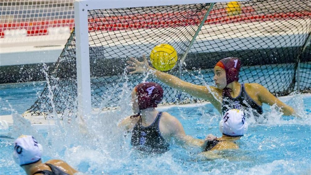 Freshman Goalie Jessica Gaudreault and Sophomore Summer Creighton block a shot together during their game against Long Beach State Saturday at the Counsilman-Billingsly Aquatic Center. The IU Women's Water Polo team lost the game 7-4 during the weekend-long Fluid Four tournament.