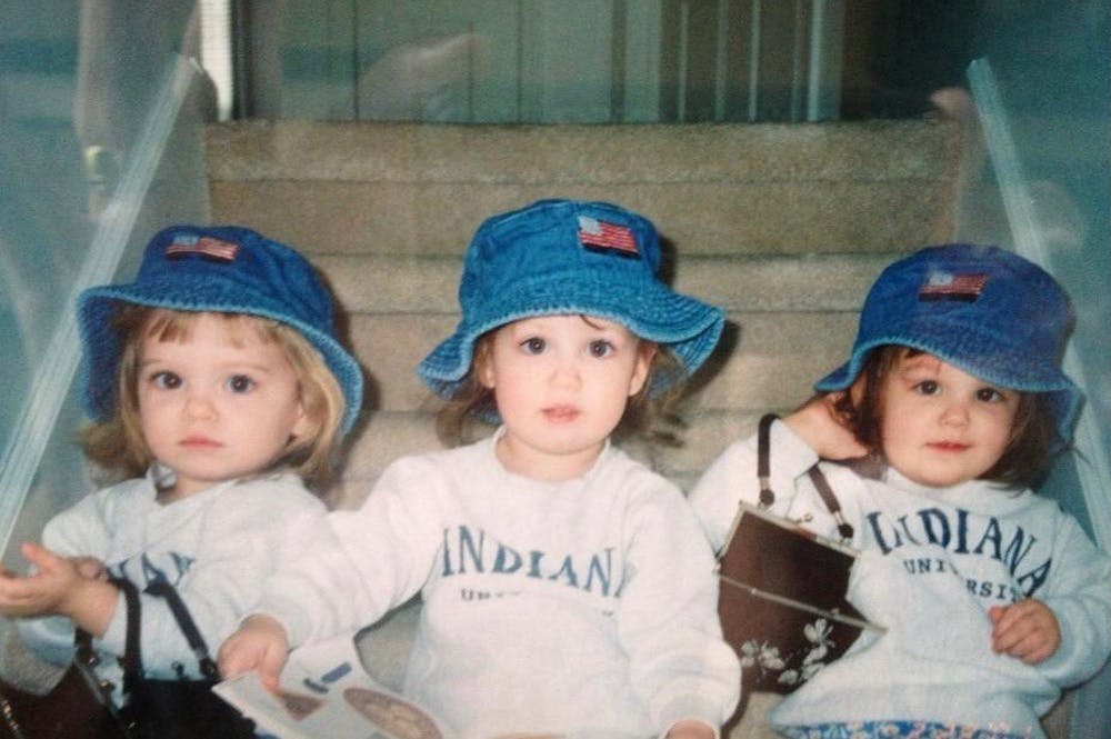 One and a half year old Ellie, Maddie and Ronnie VanBuskirk sit for a photo. The three were the only set of triplets to graduate in the class of 2021.
