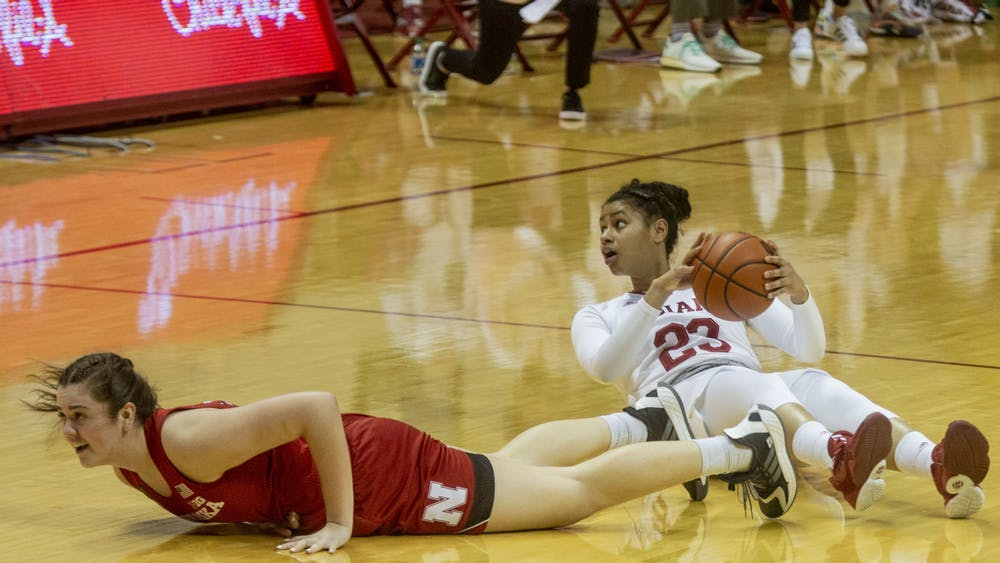Freshman Kiandra Browne holds the ball after falling to the ground Dec. 20 at Simon Skjodt Assembly Hall. Browne had a double-double in the victory over Nebraska, scoring 12 points and grabbing 10 rebounds.