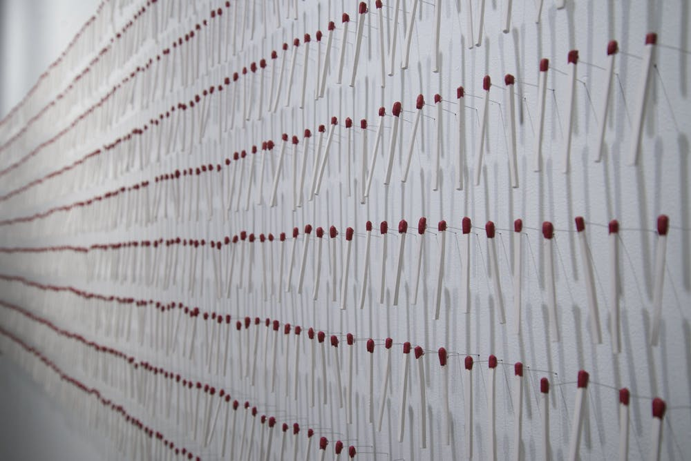 <p>Masters of fine arts student Emily Yurkevicz&#x27;s piece at the MFA Thesis Exhibit at the Grunwald Gallery of Art appears. Yurkevicz works with fibers and her piece focuses on the value of common objects, such as matches. </p>