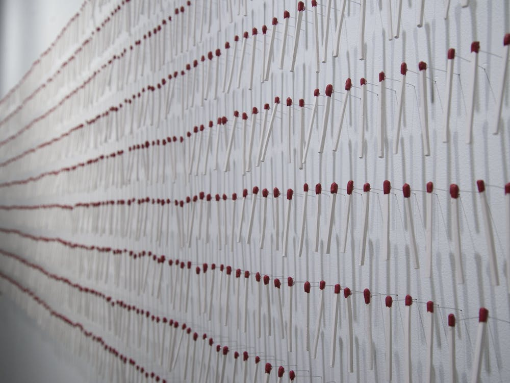 Masters of fine arts student Emily Yurkevicz's pieceat the MFA Thesis Exhibit at the Grunwald Gallery of Art appears. Yurkevicz works with fibers and her piece focuses on the value of common objects, such as matches.