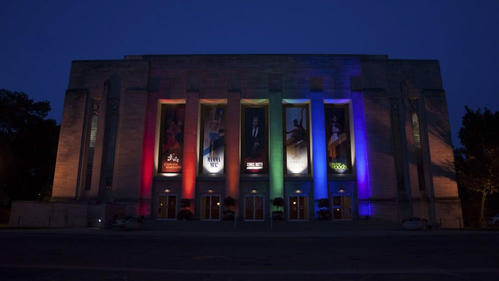 The Indiana University Auditorium lights up in Pride colors as a memorial for the Orlando mass shooting victims on Monday evening.