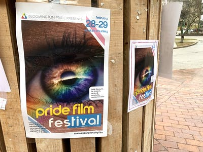 Posters for the 18th Pride Film Festival hang on a pole Feb. 24 outside Sycamore Hall. The festival will be Feb. 28-29 at the Buskirk-Chumley Theater.