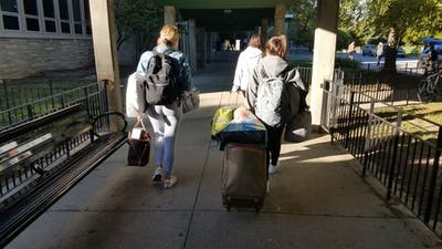 Freshmen Alessia Borzaro and Olivia Ranucci move their belongings out Oct. 17 from their room in McNutt Quad. The quad is one of many living spaces on the northwest side of campus with mold problems.