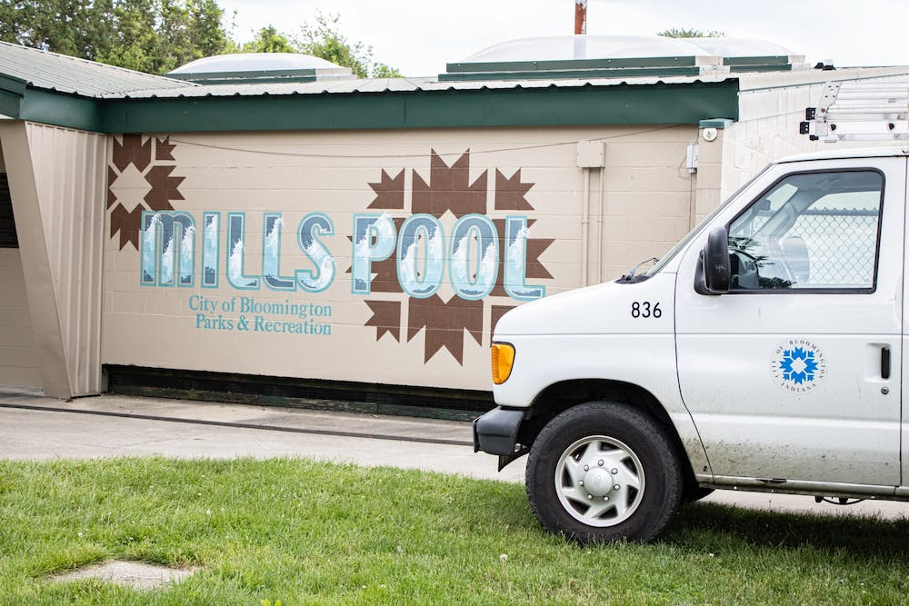 <p>A City of Bloomington truck sits outside of Mills Pool located at 1100 W 14th Street. Mills Pool will open for the first time since 2019 on Saturday.</p>