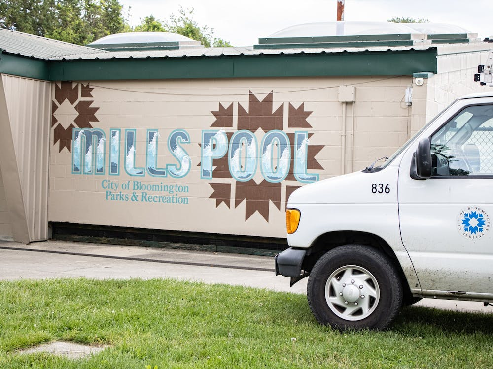 A City of Bloomington truck sits outside of Mills Pool located at 1100 W 14th Street. Mills Pool will open for the first time since 2019 on Saturday.