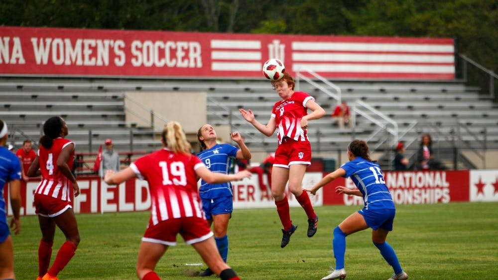 Sophomore Grace Geise heads the ball after a corner kick Friday at Bill Armstrong Stadium. IU defeated Kentucky, 5-1.