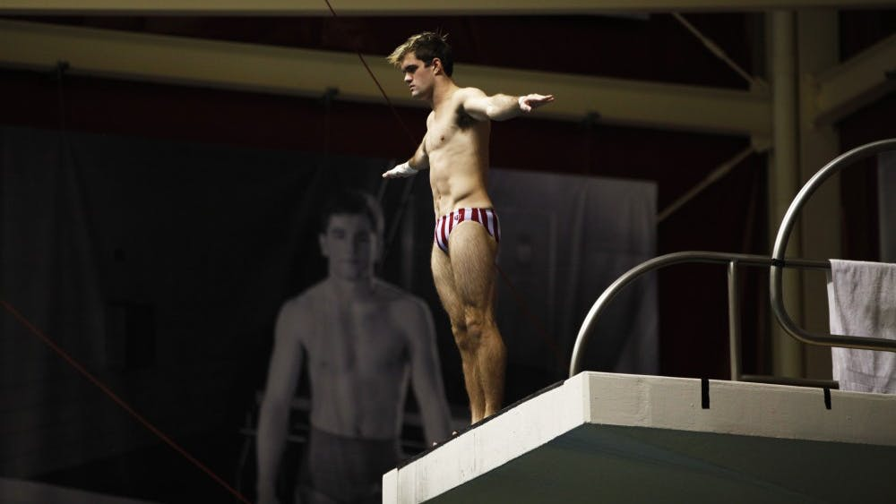 Senior Clark Carter prepares himself for his dive Nov. 17 at Counsilman Billingsley Aquatic Center. The men's swimming and diving team is currently in first at the IU Invitational.