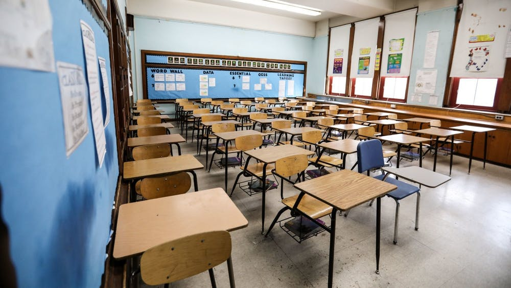 An empty middle school classroom is pictured. In contrast to statewide data, IU says the majority of their education graduates go on to teach.