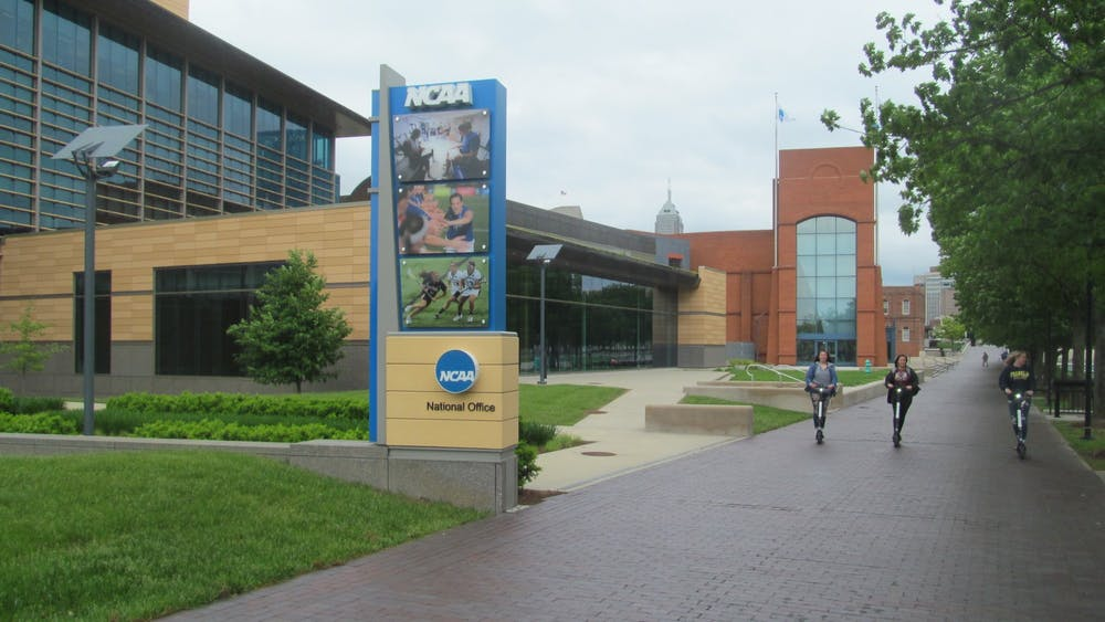 The headquarters of the NCAA in Indianapolis. The NCAA adopted an interim set of rules Wednesday, which will allow collegiate athletes to earn money for their Name, Image and Likeness.