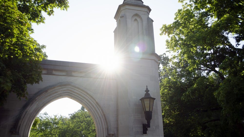 The sun peeks over Sample Gates.