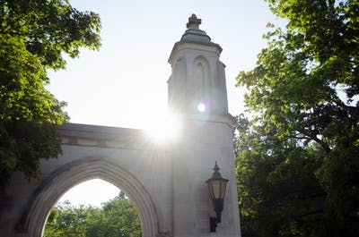 The sun peeks over Sample Gates.