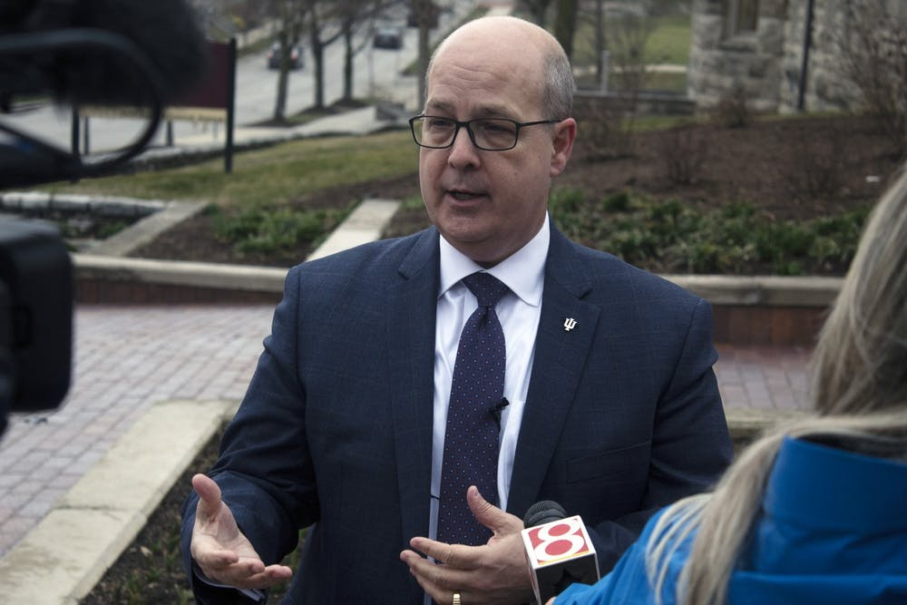 <p>IU spokesperson Chuck Carney speaks to reporters March 10 in front of the Sample Gates. IU canceled all face-to-face classes for the two weeks following spring break. </p>