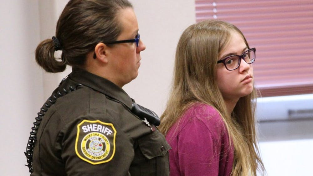 Here Morgan Geyser is brought into court by a sheriff's deputy on Aug. 21, 2015 during the arraignment of the Slenderman stabbing trial in Waukesha County Court in Waukesha, Wis. The court entered a not guilty plea for them and moved to set a trial date in mid-October. (Michael Sears/Milwaukee Journal Sentinel/TNS)