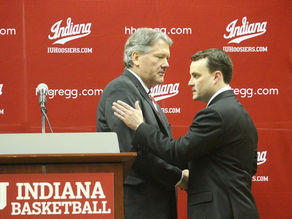 IU Coach Archie Miller and IU Athletics Director Fred Glass shake hands after the press conference to announce Miller's hiring.