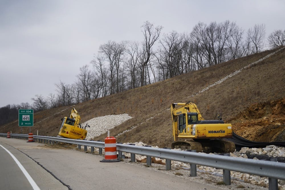 <p>Two pieces of construction equipment sit Jan. 19, 2019, on the side of Interstate 69. State Road 37 in Martinsville, Indiana, closed for construction to convert the road into I-69.</p>