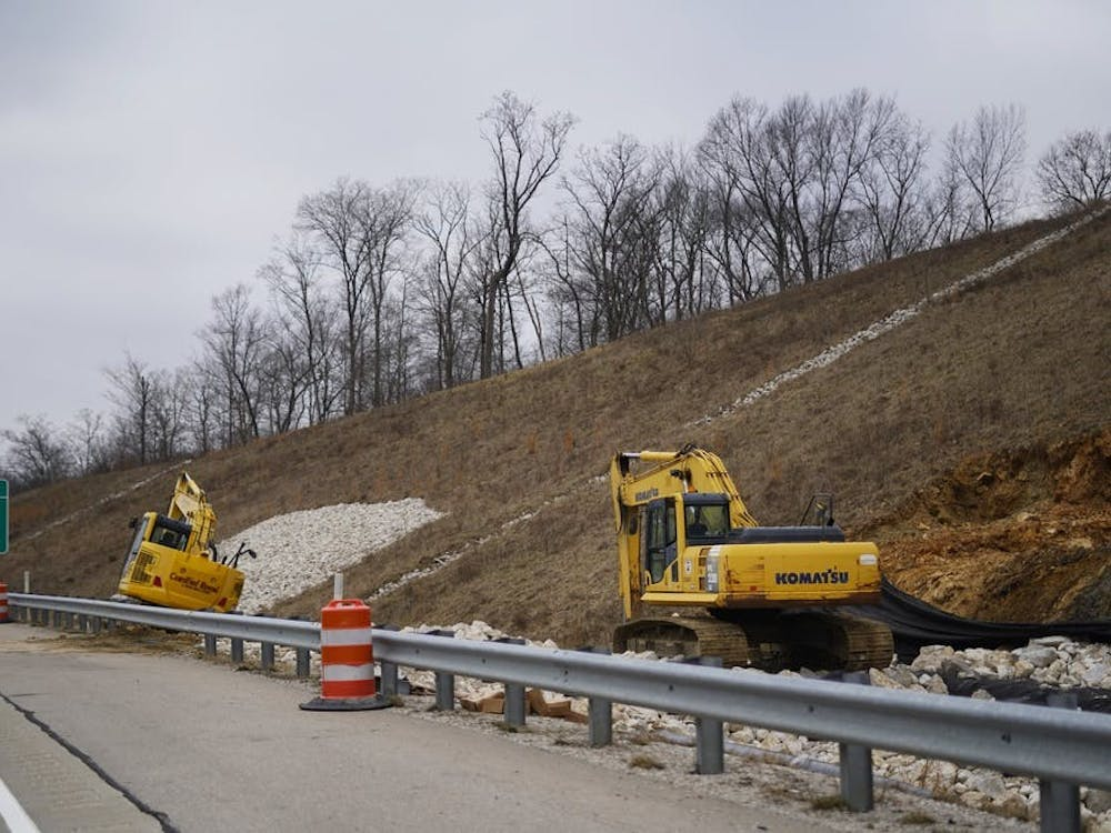 Two pieces of construction equipment sit Jan. 19, 2019, on the side of Interstate 69. State Road 37 in Martinsville, Indiana, closed for construction to convert the road into I-69.