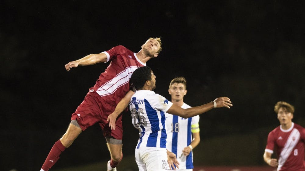 Redshirt junior A.J. Palazzolo jumps above the University of Kentucky's Nicolas Blassou for a header during the Oct. 9 draw between the two teams at Bill Armstrong Stadium. The match marked IU's sixth overtime match of the season.