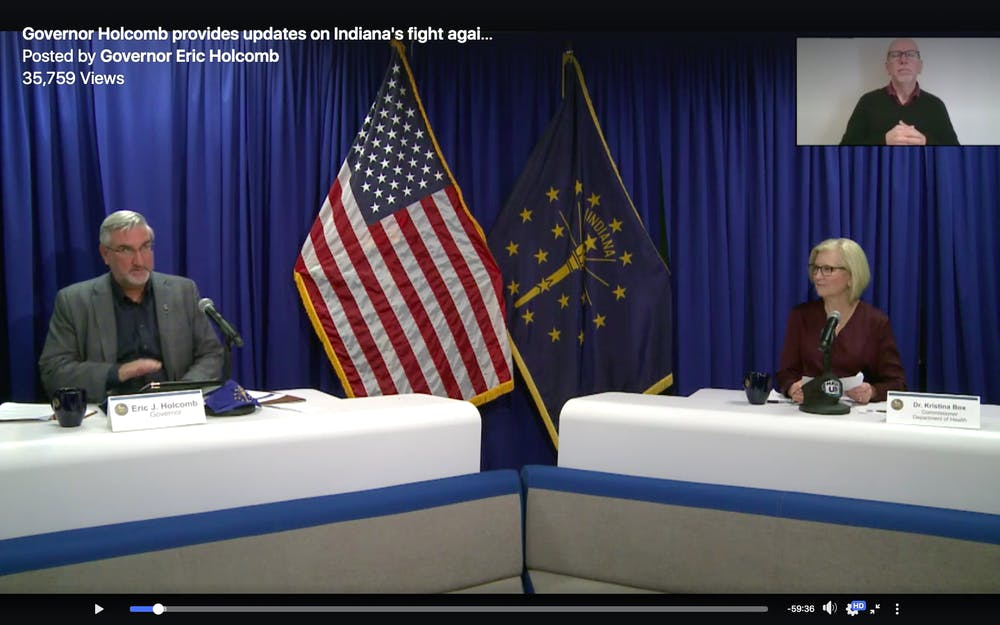 <p>Gov. Eric Holcomb and Dr. Kristina Box, Indiana&#x27;s state health commissioner, speak Wednesday during Holcomb&#x27;s press conference over Zoom. Box said Indiana is preparing to receive limited amounts of the Pfizer and Moderna COVID-19 vaccines as early as mid-December. </p>