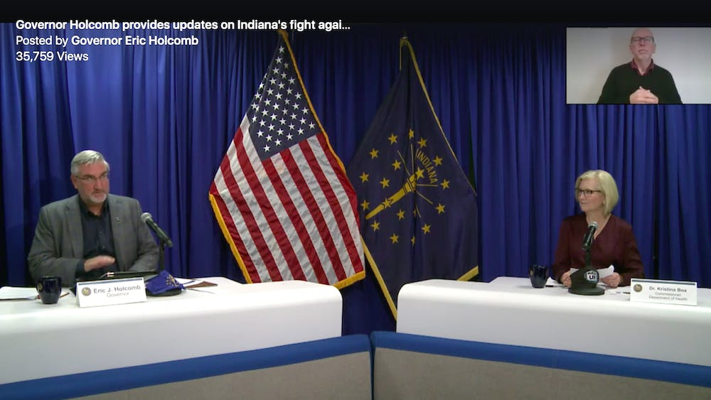 Gov. Eric Holcomb and Dr. Kristina Box, Indiana's state health commissioner, speak Wednesday during Holcomb's press conference over Zoom. Box said Indiana is preparing to receive limited amounts of the Pfizer and Moderna COVID-19 vaccines as early as mid-December.