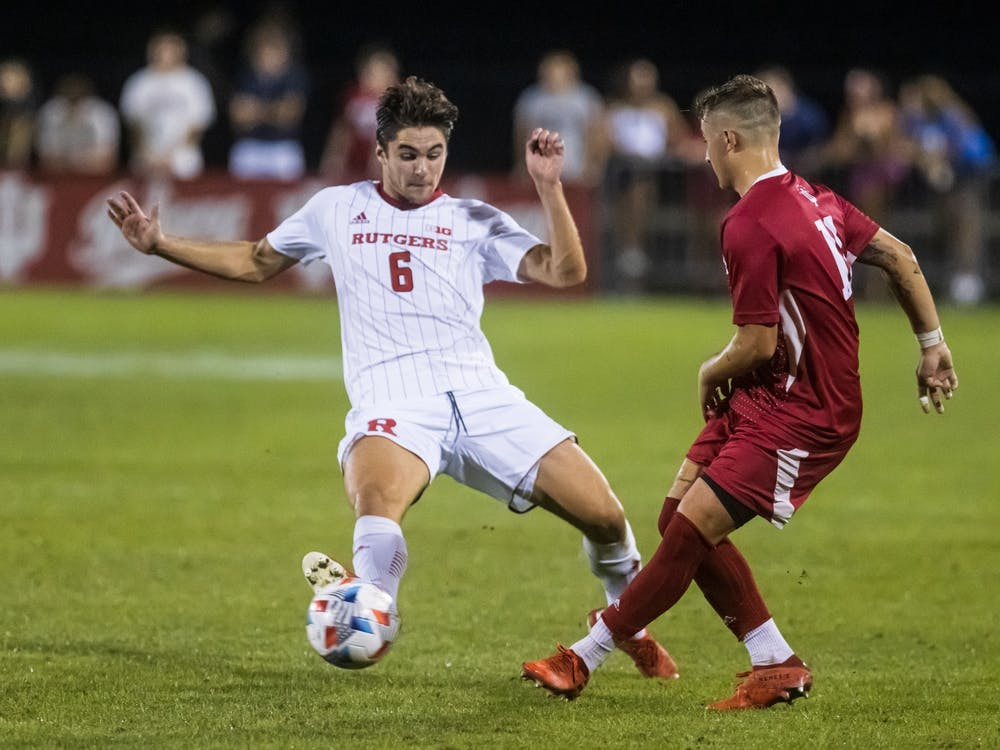 Senior defender Nyk Sessock passes the ball Sept. 17, 2021, at Bill Armstrong Stadium. Indiana men's soccer will play Northwestern at 8 p.m. Tuesday in Evanston, Illinois.