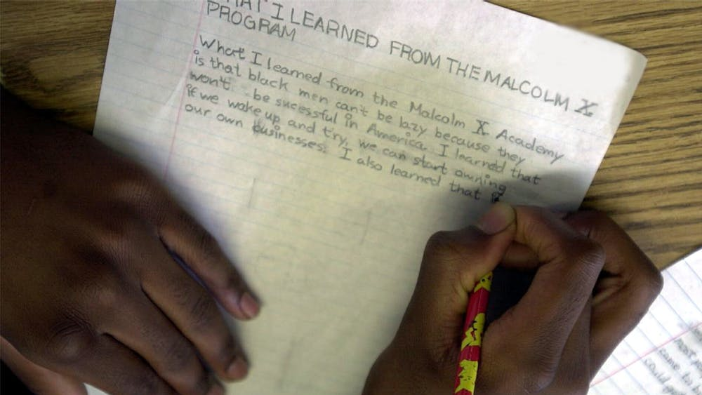 A student at the Malcolm X Academy in Richmond, California, writes an essay about what they learned in the program. To celebrate Black History Month this year, the City of Bloomington is putting on a youth essay contest.