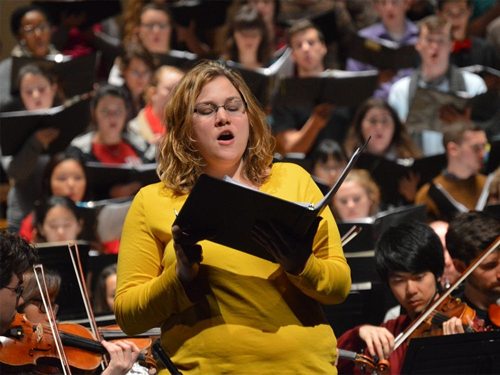 """Megan Wilhelm, second-year master's student in the Jacobs School of Music, practices her solo during rehearsal for """"Vaughan Williams: 'A Sea Symphony.'"""" The oratorio Chorus and Concert Orchestra will perform the piece at 8 p.m. today in the Musical Arts Center."""