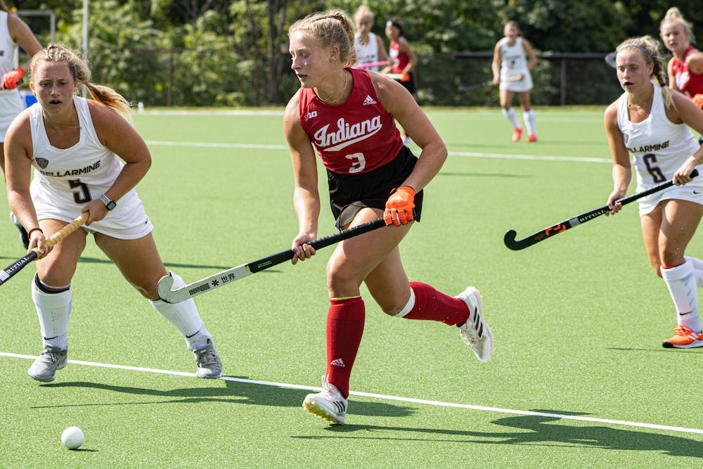 <p>Freshman Kayla Kiwak runs with the ball during a match against Bellarmine on Sept. 6, 2021, at the IU Field Hockey Complex. Indiana improved to 4-1 on the year after winning twice over the weekend.</p>