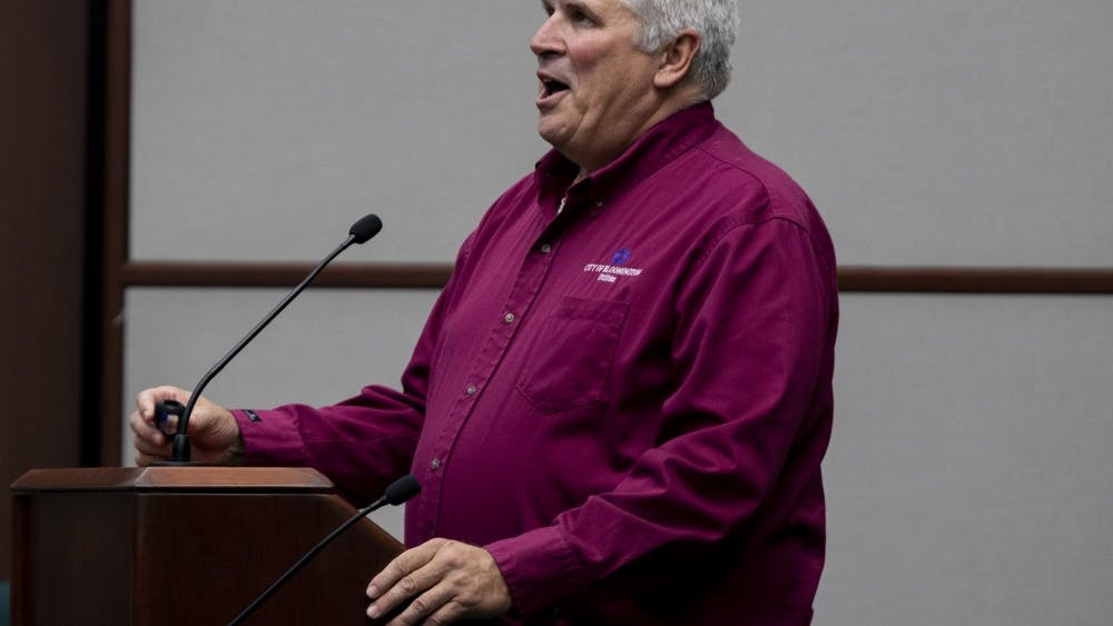 "Director of Utilities Vic Nelson speaks during a city council meeting Sept. 11 at City Hall. ""We're looking at an outstanding debt in the sewage works,"" he said."