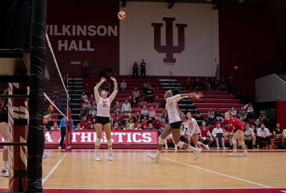<p>Freshman Emily Fitzner sets to senior Deyshia Lofton Oct. 26 against Iowa at Wilkinson Hall. IU volleyball lost to Purdue on Wednesday in West Lafayette, Indiana.</p>