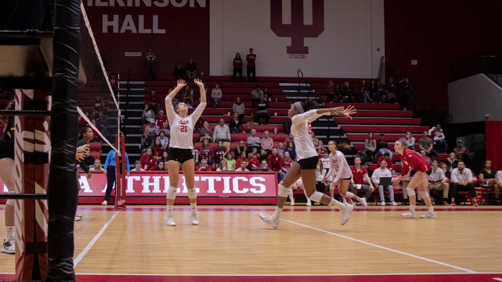Freshman Emily Fitzner sets to senior Deyshia Lofton Oct. 26 against Iowa at Wilkinson Hall. IU volleyball lost to Purdue on Wednesday in West Lafayette, Indiana.