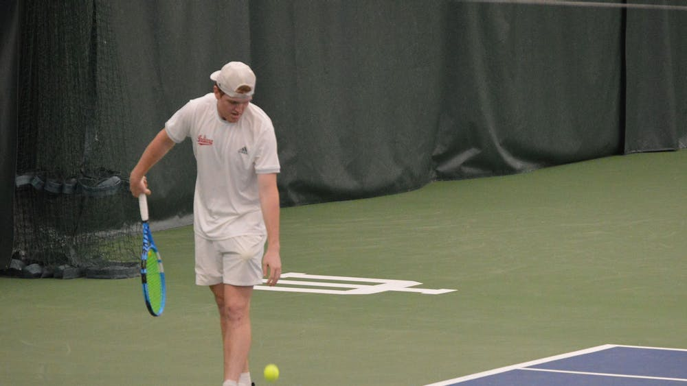 Junior Patrick Fletchall prepares to serve the ball April 11 at the IU Tennis Center. The IU men's tennis team lost 0-4 Saturday to No. 16 Illinois at home.