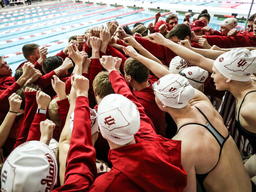 The IU women's swim and dive team huddles. Freshman swimmer Ryley Ober was training for the NCAA Championships before spring sports were canceled.