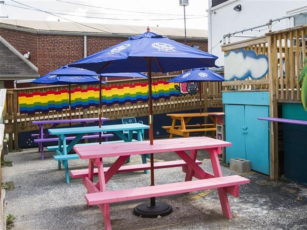 Rainbow colored tables line the outside of The Back Door.