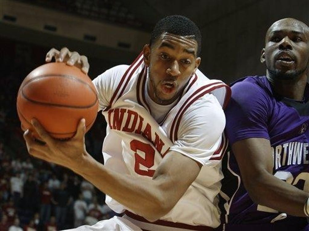 Freshman forward Christian Watford, left, grabs a rebound from Northwestern guard Jeremy Nash during the first half in Bloomington on Saturday.