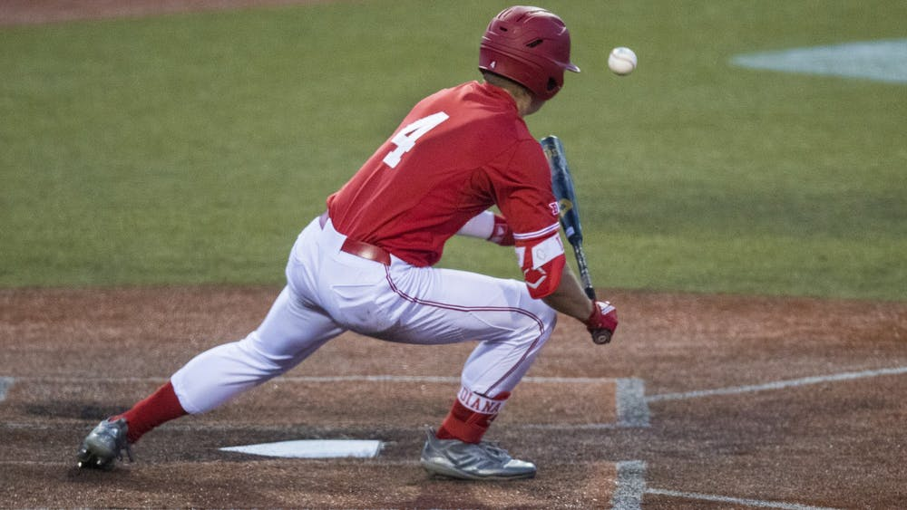 Freshman Hunter Jessee bunts the ball March 7 at Bart Kaufman Field. The University of San Diego defeated IU 5-13 March 8.