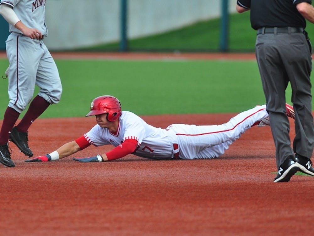 Matt Gorski slides in to second base on Friday at Bart Kaufman Field. IU lost to Minnesota 11-0.