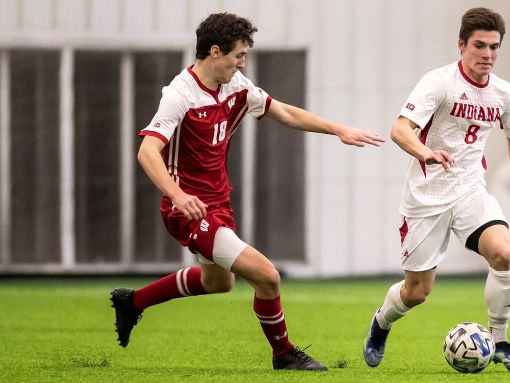 Sophomore forward Victor Bezerra runs the ball up the field Feb. 19 at Grand Park in Westfield, Indiana. Bezerra had two goals in IU's win against Maryland on Wednesday.