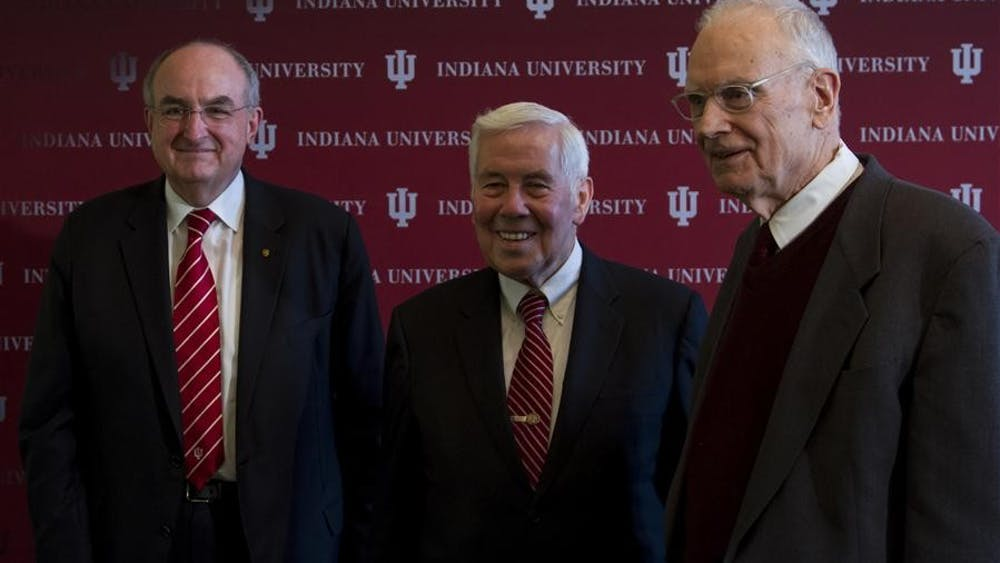 Former Indiana Sen. Richard Lugar poses for a photo with Lee Hamilton and IU president Michael McRobbie on Thursday afternoon at the Lilly Library. McRobbie announced that Lugar and Hamilton will become faculty members at IU's School of Global and International Studies.