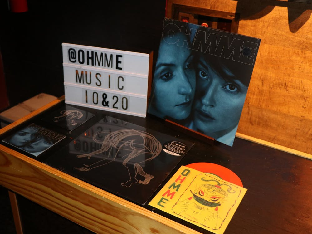 Chicago rock group OHMME's merchandise is displayed Wednesday in the Bishop Bar. The duo kicked off its national tour with the 9 p.m. concert.