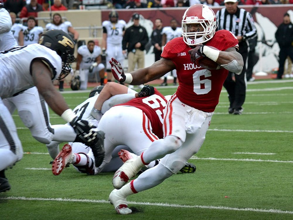 Then-junior running back Tevin Coleman gets ready to stiff-arm a defender during IU's game against Purdue on Nov. 29, 2014, at Memorial Stadium. Coleman made the Super Bowl this year with the San Francisco 49ers and will look to build on his success this season.
