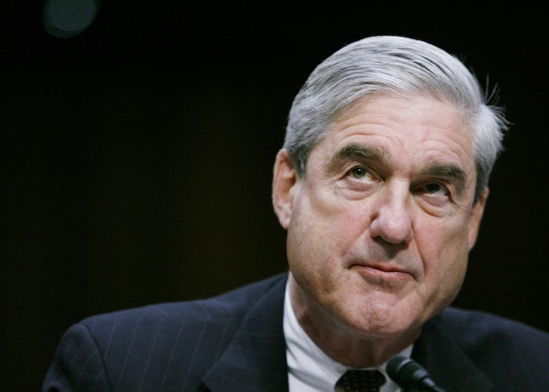 """Robert Mueller testifies before a Senate Intelligence Committee hearing in February 2011 in Washington, D.C. Attorney General William Barr told Congress on Sunday that special counsel Robert Mueller did not find that Donald Trump's presidential campaign """"or anyone associated with it conspired or coordinated with Russia"""" in 2016."""