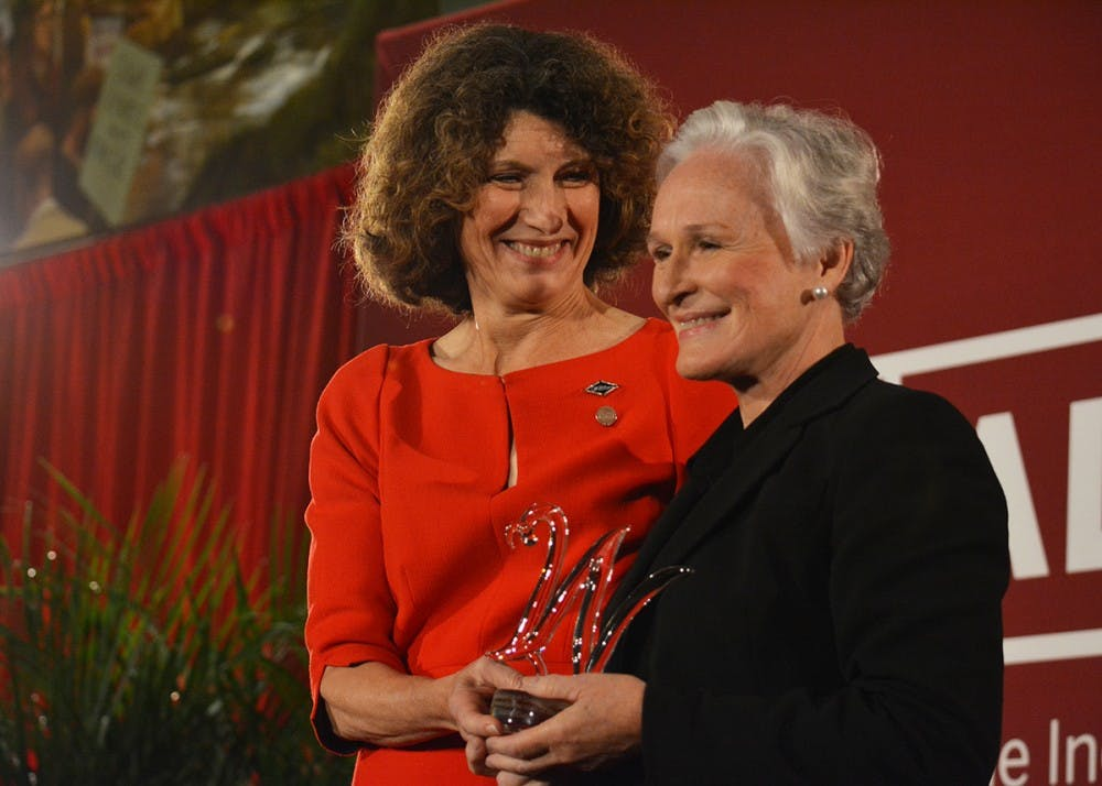 <p>IU's First Lady, Laurie Burns McRobbie, presents actress Glenn Close with the Women Leading the Way award during a IU Bicentennial Campaign celebration Saturday afternoon. This award is the highest honor the Women's Philanthropy Leadership Council can give, McRobbie said.</p>