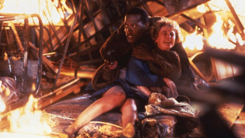 """Tony Todd and Virginia Madsen in the 1992 film """"Candyman"""". Nia DaCosta directed the fourth film in the series, which premiered Aug. 27, 2021."""