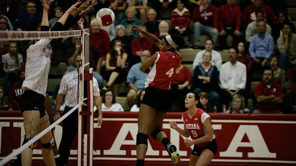 Redshirt senior Chanté George spikes the ball during a game against Maryland on Friday night. The Hoosiers won 3-1.