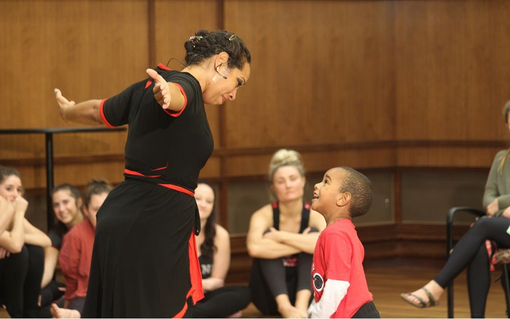 Dancer, Nyama McCarthy-Brown, and her son Kasim McCarthy-Brown do a dance performance together during the Embodied Conversations on Racism program Tuesday at Franklin Hall. The piece discribes how young African American boys should be protected and taught at a young age the facts of their future lives.