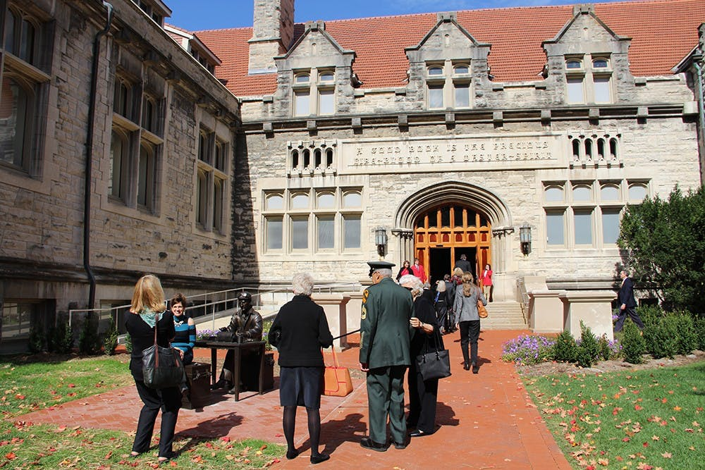 People admire the statue of Ernie Pyle before the Media School Inauguration on Friday at Franklin Hall.