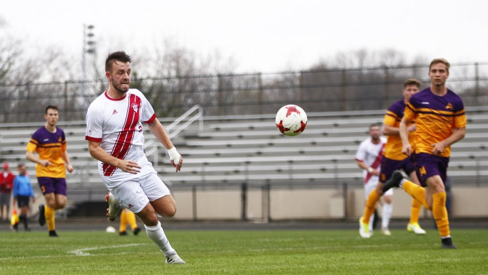 Sophomore Thomas Warr goes after the ball April 7 at Bill Armstrong Stadium. IU beat Lipscomb University, 3-0.